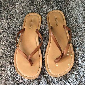 Volcom tan flip flops